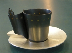 Cup and saucer part oxidised